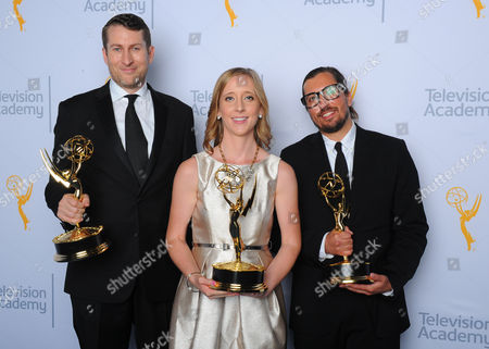 """Scott Aukerman, from left, Michelle Fox and Sean Boyle, winners of the award for outstanding short format live action entertainment program for """"Between Two Ferns with Zack Galifianakis"""", pose for a portrait at the Television Academy's Creative Arts Emmy Awards at Microsoft Theater, in Los Angeles"""