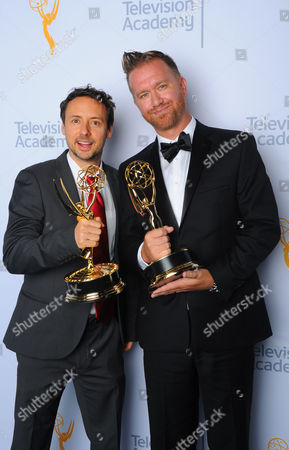 "Stock Photo of Kyle Dunnigan, left, and Jim Roach, winners of the award for outstanding original music and lyrics for ""Inside Amy Schumer"", pose for a portrait at the Television Academy's Creative Arts Emmy Awards at Microsoft Theater, in Los Angeles"