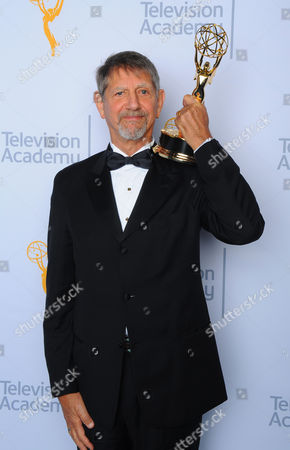 """Peter Coyote, winner of the award for outstanding narrator for """"The Roosevelts: An Intimate History"""", poses for a portrait at the Television Academy's Creative Arts Emmy Awards at Microsoft Theater, in Los Angeles"""