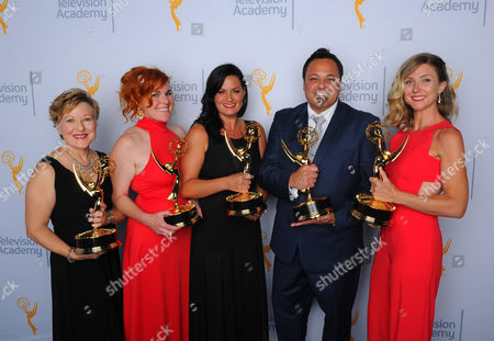 "Inga Thrasher, from left, Jennifer Serio, Jodi Mancuso, Joe Whitmeyer and Cara Hannah, winners of the award for outstanding hairstyling for a multi camera series or special for ""Saturday Night Live"", pose for a portrait at the Television Academy's Creative Arts Emmy Awards at Microsoft Theater, in Los Angeles"