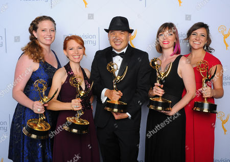 Katie, Rorick, from left, Tamara Krinsky, Bernie Su, Alexandra Edwards, and Tracey Bitterrolf pose for a portrait at the Television Academy's Creative Arts Emmy Awards at Microsoft Theater, in Los Angeles
