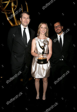 Scott Aukerman, from left, Michelle Fox, and Sean Bayle pose for a portrait at the Television Academy's Creative Arts Emmy Awards at Microsoft Theater, in Los Angeles