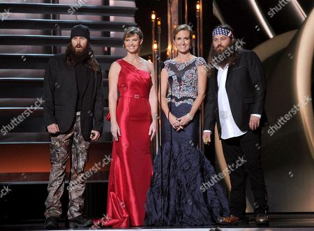 """From left, """"Duck Dynasty"""" cast members Jase Robertson, Missy Robertson, Korie Robertson and Willie Robertson speak onstage at The 47th Annual CMA Awards, on at Bridgestone Arena in Nashville, Tenn"""