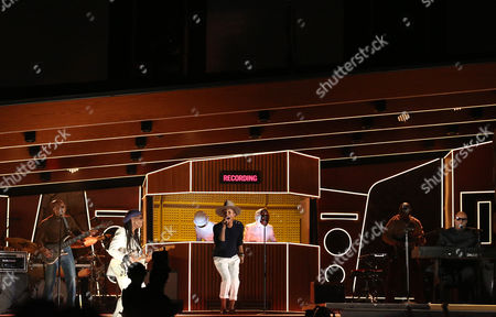 Stock Picture of Nile Rodgers, from second left, Thomas Bangalter, Pharrell Williams, Guy-Manuel de Homem-Christo, and Stevie Wonder perform at the 56th annual Grammy Awards at Staples Center, in Los Angeles