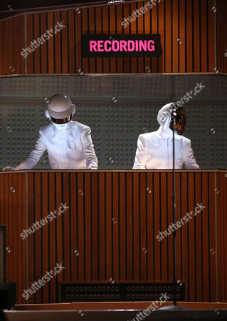 Thomas Bangalter, left, and Guy-Manuel de Homem-Christo of Daft Punk perform at the 56th annual Grammy Awards at Staples Center, in Los Angeles