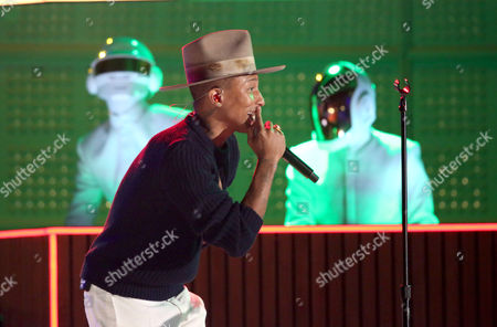 Stock Image of Pharrell Williams performs with Thomas Bangalter, background left, and Guy-Manuel de Homem-Christo of Daft Punk, at the 56th annual Grammy Awards at Staples Center, in Los Angeles