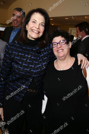 Sherry Lansing, left, and Karen Rosenfelt attend The Hollywood Reporter's celebration of power 100 women in entertainment breakfast on in Beverly Hills, Calif