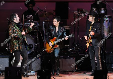 """Musicians Steve Wickham, left, and Mike Scott from The Waterboys perform with guitarist Wendy Melvoin, center, at """"The Music of Prince"""" tribute concert at Carnegie Hall on in New York"""
