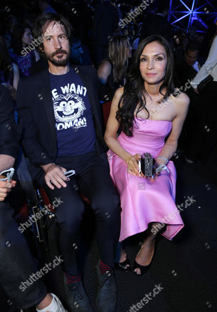 Stock Photo of Cole Frates and Famke Janssen seen at the Twentieth Century Fox Global Premiere of 'X-Men: Days of Future Past' held at the Jacob K. Javits Convention Center, in New York City