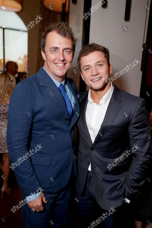 """Director/Writer Garth Jennings and Taron Egerton seen at Universal Pictures """"Sing"""" after party at the 2016 Toronto International Film Festival, in Toronto"""
