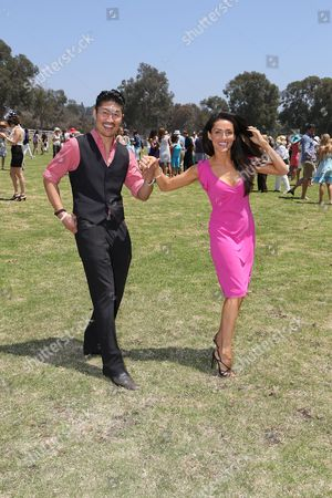 From left, Brian Tee and Mirelly Taylor-Tee at the divot stomp during the Will Rogers Dog Iron Polo Cup event at the Will Rogers State Historic Park polo field, in Pacific Palisades, Calif