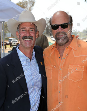 From left, Wyatt McCrea (Grandson of western actor Joel McCrea) and actor Rex Linn pose during the Will Rogers Dog Iron Polo Cup event at the Will Rogers State Historic Park polo field, in Pacific Palisades, Calif