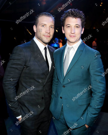 """Jai Courtney, left, and Miles Teller pose together at the after party for the world premiere of """"Divergent"""" on in Los Angeles"""