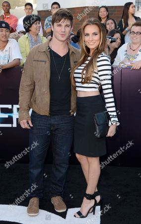 """Matt Lanter, left, and Angela Stacy arrive at the world premiere of """"Divergent"""" at the Westwood Regency Village Theater, in Los Angeles"""