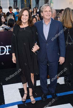 """Lucy Fisher, left, and Douglas Wick arrive at the world premiere of """"Divergent"""" at the Westwood Regency Village Theater, in Los Angeles"""