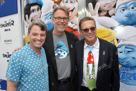 "From left, Bob Osher, president of Sony Pictures Digital Productions, director Raja Gosnell and producer Jordan Kerner arrive to the world premiere of ""The Smurfs 2"" at the Regency Village Theatre on in Los Angeles"