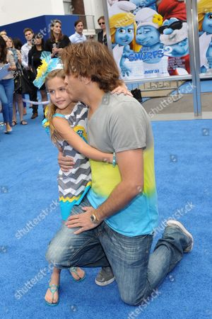 """Larry Birkhead, right, and Dannielynn Marshall arrive to the world premiere of """"The Smurfs 2"""" at the Regency village Theatre on in Los Angeles"""