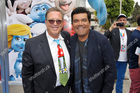 "Producer Jordan Kerner, left, and George Lopez arrive to the world premiere of ""The Smurfs 2"" at the Regency village Theatre on in Los Angeles"