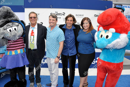 "From left, producer Jordan Kerner, Bob Osher, president of Sony Pictures Digital Production, composer Heitor Pereira and Michelle Raimo Kouyate, president of Sony Pictures Animation arrive to the world premiere of ""The Smurfs 2"" at the Regency village Theatre on in Los Angeles"