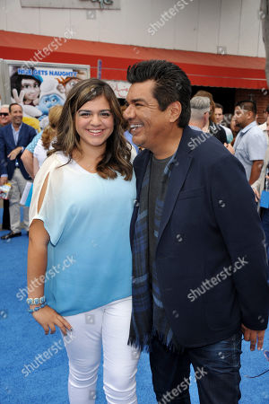 """Actor George Lopez, right, and Mayan Lopez arrive to the world premiere of """"The Smurfs 2"""" at the Regency Village Theatre on in Los Angeles"""