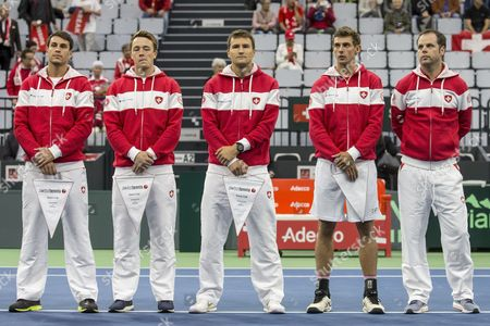 Swiss Davis Cup Team with Luca Margaroli, Adrian Bodmer, Marco Chiudinelli, Henri Laaksonen and Swiss Davis Cup Team captain Severin Luethi, from left, during the opening ceremony of the Davis Cup world group playoffs between Switzerland and Belarus at the Swiss Tennis Arena in Biel, Switzerland, 15 September 2017.