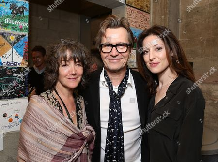"""From left, Anwen Rees-Myers, actor Gary Oldman and wife Alexandra Edenborough pose backstage after the opening night performance of """"Krapp's Last Tape"""" at Center Theatre Group's Kirk Douglas Theatre, in Culver City, Calif"""