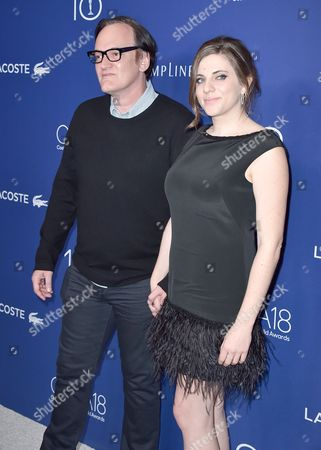 Quentin Tarantino, left, and Courtney Hoffman arrive at the 18th annual Costume Designers Guild Awards at the Beverly Hilton hotel, in Beverly Hills, Calif