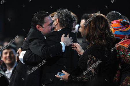 "Mario Quintero Lara, left, lead singer for Los Tucanes De Tijuana is congratulated before accepting the award for best norteno album for ""365 Dias"" at the 13th Annual Latin Grammy Awards at Mandalay Bay, in Las Vegas"