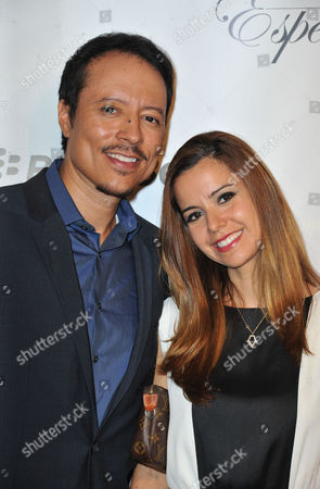Yancey Arias, atleft, and his wife, Anna Alvim arrives at the 2013 El Sueno De Esperanza Gala at the Club Nokia L.A. Live on in Los Angeles
