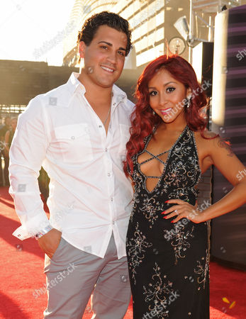 Nicole Polizzi From left, Jionni LaValle and Nicole 'Snooki' Polizzi arrive at the MTV Video Music Awards, at the Barclays Center in the Brooklyn borough of New York