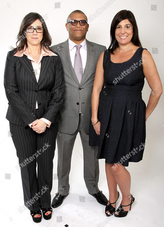 Oscar nominees Stacey Sher, left, Reginald Hudlin, center, and Pilar Savone pose for a portrait at the 2013 Oscar Nominee Luncheon on in Los Angeles