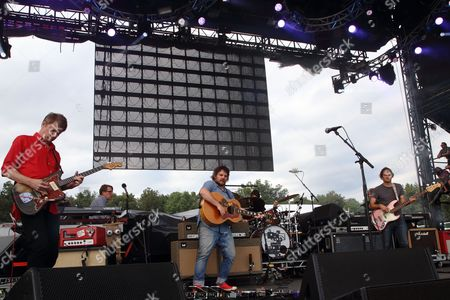 Nels Cline, Jeff Tweedy, John Stirratt (L-R) and Wilco performs at the 2014 Lockn' Festival, in Arrington, Virginia