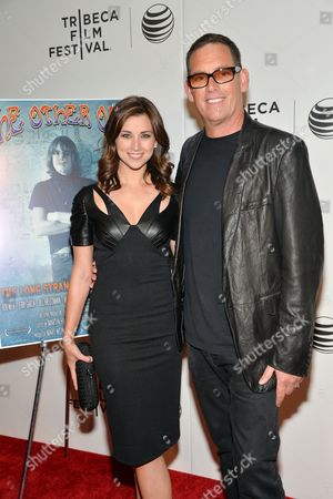 """Director Mike Fleiss and wife Laura attend the premiere of """"The Other One: The Long, Strange Trip of Bob Weir"""" during 2014 Tribeca Film Festival, in New York"""
