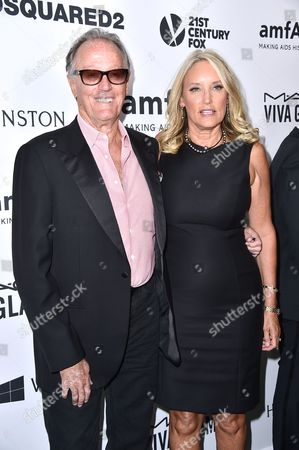 Peter Fonda and Parky Fonda arrive at the amfAR Inspiration Gala at Milk Studios, in Los Angeles