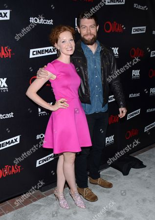 """Stock Image of Wren Schmidt and Parick Fugit arrive at the red carpet photocall for FOX International Studios' Comic-Con Party celebrating Robert Kirkman's new drama """"Outcast"""" at Andaz Hotel San Diego on in San Diego, Calif"""