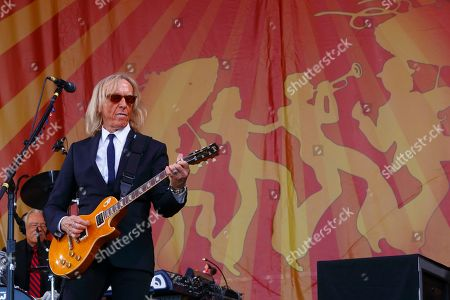 Davey Johnstone performs with Elton John at the New Orleans Jazz & Heritage Festival, in New Orleans, Louisiana