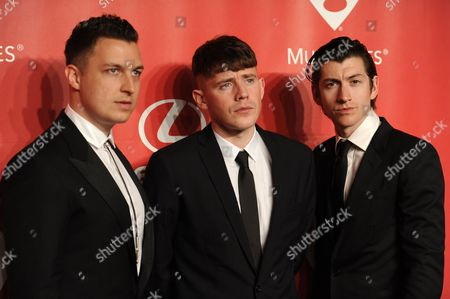 From left, Matt Helders, Jamie Cook, and Alex Turner of the Arctic Monkeys arrive at the 2015 MusiCares Person of the Year event at the Los Angeles Convention Center on in Los Angeles