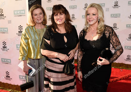 """Left to right, Heather Menzies-Urich, Debbie Turner, center, and Kym Karath, cast members in the classic film """"The Sound of Music,"""" pose together at a 50th anniversary screening of the film on the opening night of the 2015 TCM Classic Film Festival, in Los Angeles"""