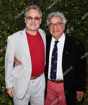 """Barry Pearl, left, and Michael Tucci, cast members in the film """"Grease,"""" pose together before a 50th anniversary screening of the film """"The Sound of Music"""" at the opening night gala of the 2015 TCM Classic Film Festival, in Los Angeles"""