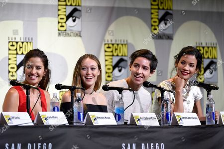 """Mercedes Mason, from left, Alycia Debnam Carey, Lorenzo James Henrie and Danay Garcia attend the """"Fear the Walking Dead"""" panel on day 2 of Comic-Con International, in San Diego"""
