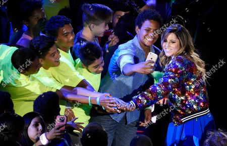 Brazilian skateboarder Leticia Bufoni poses with young fans in the audience during the 2016 Kids' Choice Sports Awards at Pauley Pavilion, in Los Angeles