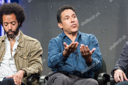 """Wyatt Cenac, left, and Oscar Nunez participate in the """"People on Earth"""" panel during the Turner Networks TV Television Critics Association summer press tour, in Beverly Hills, Calif"""