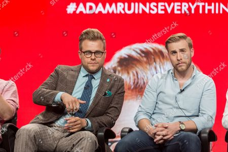 """Adam Conover, left, and Travis Helwig participate in the Tru TV """"Adam Ruins Everything"""" panel during the Turner Networks TV Television Critics Association summer press tour, in Beverly Hills, Calif"""