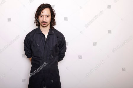 """Writer and director Jason Lew poses for a portrait to promote the film, """"The Free World,"""" at the Toyota Mirai Music Lodge during the Sundance Film Festival, in Park City, Utah"""