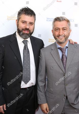 Stock Photo of Evgeny Afineevsky, left, and Den Tolmor arrive at the 2016 Television Academy Honors at The Montage Hotel, in Beverly Hills, Calif
