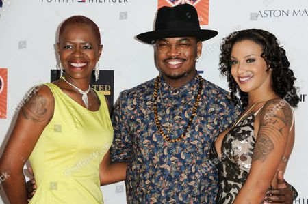 Stock Image of Monyetta Shaw, from left, Ne-Yo, Loraine Smith arrive at the 22nd Annual Race To Erase MS Event held at the Hyatt Regency Century Plaza Hotel, in Los Angeles