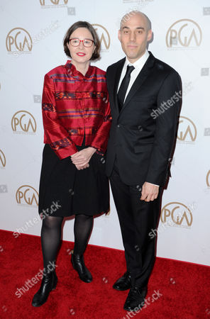 Signe Byrge Sorensen, left, and Joshua Oppenheimer arrive at the 27th Annual Producers Guild Awards at the Hyatt Regency Century Plaza, in Los Angeles