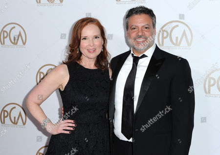 Jennifer Todd, left, and Michael De Luca arrive at the 27th Annual Producers Guild Awards at the Hyatt Regency Century Plaza, in Los Angeles