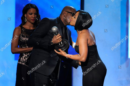 NAACP chairman Roslyn M. Brock, right, presents Forest Whitaker with the chairman award at the 45th NAACP Image Awards at the Pasadena Civic Auditorium, in Pasadena, Calif