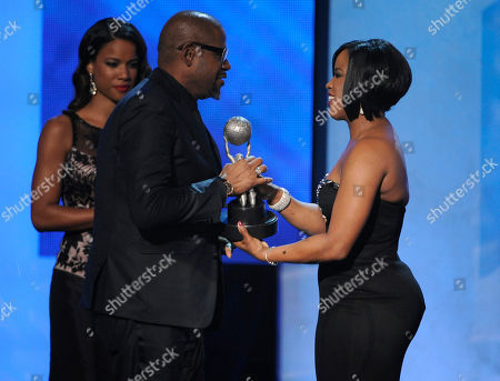 NAACP chairman Roslyn M. Brock, right, presents the chairman award to Forest Whitaker at the 45th NAACP Image Awards at the Pasadena Civic Auditorium, in Pasadena, Calif